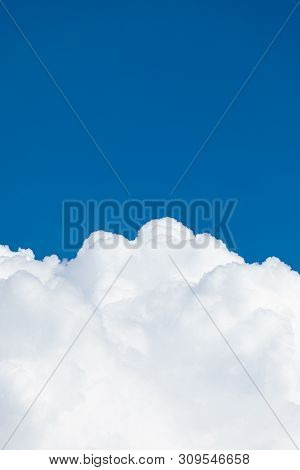 Rising Storm Cloud And Blue Sky Scape In Sunshine
