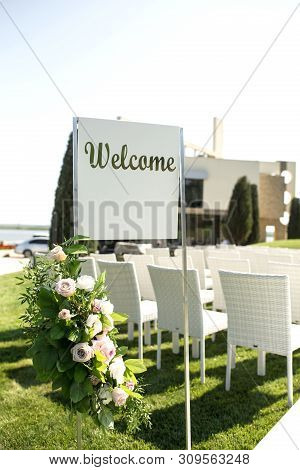 Beautiful Outgoing Wedding Set Up. Romantic Wedding Ceremony , Wedding Outdoor On The Lawn Water Vie