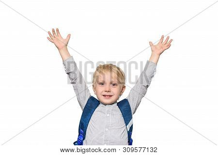 Portrait Of A Joyful Blond Schoolboy With A School Bag. Hands Up. Isolate