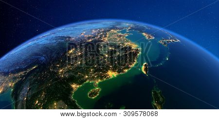 Planet Earth With Detailed Exaggerated Relief At Night Lit By The Lights Of Cities. Eastern China An