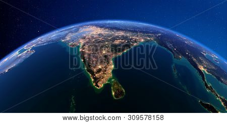 Planet Earth With Detailed Exaggerated Relief At Night Lit By The Lights Of Cities. India And Sri La