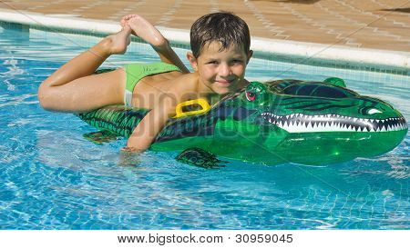 Kid Playing At The Swimming Pool