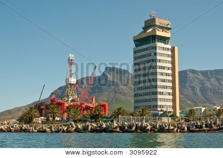 Oil- Rig In Bay Of Big City Near Mountains