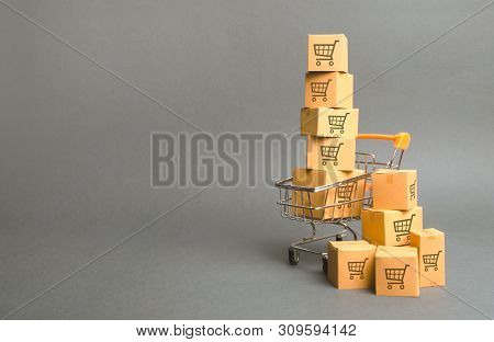 Shopping Cart And Boxes With Drawing Of Smaller Carts. Goods Sale. Commerce, Online Shopping. Purcha