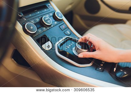 Close Up Young Woman Hand On Automatic Gear Shift, Shifting Gearbox In Car.driver Woman Hand Holding