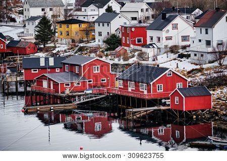 Reine fishing village on Lofoten islands with red rorbu houses in winter with snow. Lofoten islands, Norway