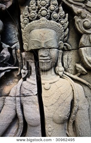 Cracked Carving Of Woman In Ankgor Temple