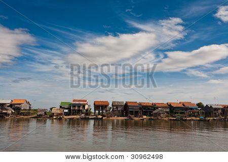 Row Of Stilt Houses Along Tonle Sap Lake