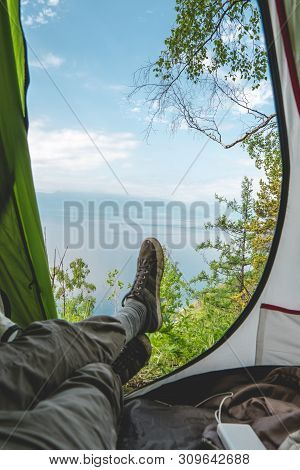 View From The Tent On Lake Baikal Among The Pine Trees From The Hill. Recreation In The Beautiful Pl