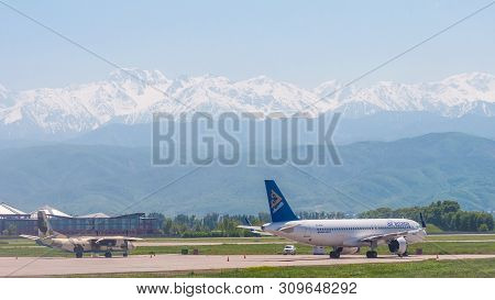 Almaty, Kazakhstan - May 10, 2019: View From The Airfield Of Almaty On The Zaili Alatau. Parked Airb
