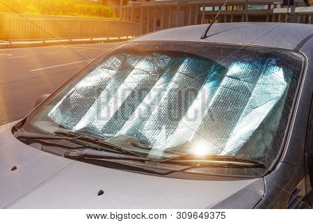 Protective Reflective Surface Under The Windshield Of The Passenger Car Parked On A Hot Day, Heated