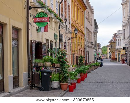 Gyor Hungary 05 07 2019 A Cozy Little Pub Terrace With Flowers