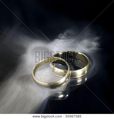 Golden Wedding Rings And Smoke