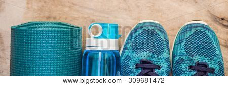 Everything For Sports Turquoise, Blue Shades On A Wooden Background. Yoga Mat, Sport Shoes Sportswea