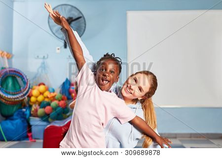 Girl and sports teacher make gymnastics and fun in pre-school physical education