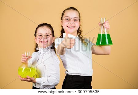 Fascinating experiment. Basic knowledge. Knowledge day. Schoolgirls friends with chemical liquids. Childhood and upbringing. Knowledge and information. Experimenting together. Education concept poster