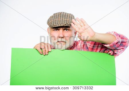 poster of wanted. Copy space placate information. serious mature man in retro hat. Advertisement. Advertisement shop. job search. Need help. bearded man place announcement on banner. pointing your advertising