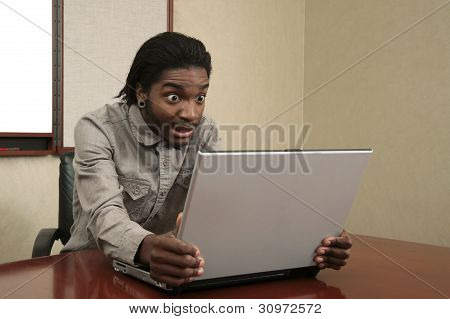 Unhappy Man Looking At A Laptop
