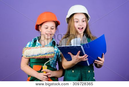 Kids girls planning renovation. Children sisters run renovation their room. Amateur renovation. Sisters renovating home. Home improvement activities. Kids choosing paint colour for their new room poster