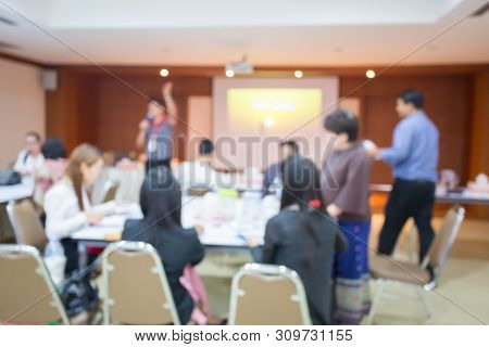 Blurry Image. Speaker Or Lecturer With Startup Business Team Brainstorming On Meeting Workshop. Team