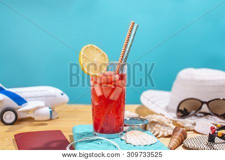 Glass Of Red Lemonade Drink With Lemon And Straw On The Table. Accessories For Summer Sunny Holidays