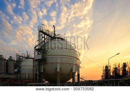 Gas Storage Sphere Tanks And Pipeline In Petrochemical Industrial Plant On Sky Sunset Background, Ma