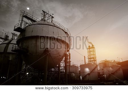 Gas Storage Sphere Tank In Oil And Gas Refinery Industrial Plant On Sky Sunset Background, Manufactu
