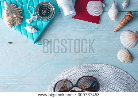Accessories For Summer Sunny Holiday In The Resort. Items For Travel To The Sea Laid Out On A Wooden