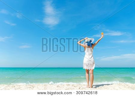 Summer Day. Lifestyle  Woman Wearing White Dress Fashion Summer Beach  On The Sandy Ocean Beach. Hap