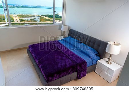 Double-bed With A Violet Coverlet In The Interior. Modern Repair.