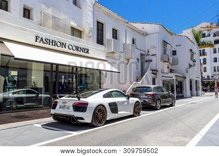 Puerto Banus, Spain - May 26, 2019: Puerto Banus Shopping Street With An Audi R8, V10, G-evolve At N