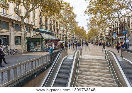 Barcelona, Spain- 09 November 2014: View Of The La Rambla, The Most Popular Street In Barcelona. Bui