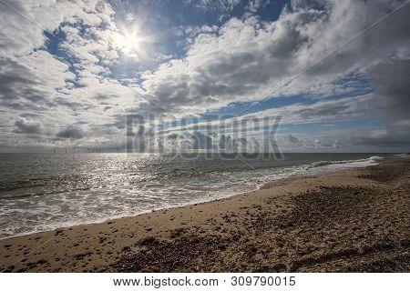 Coast. Dramatic Weather Sky Landscape Seascape. Offshore Wind Turbine Farm. English Coastal Scene Wi
