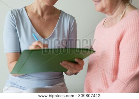 Questionnaire  Female Hand Writing Closeup Two Women Research