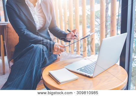 Businesswomen Are Working Using Computer In Office.