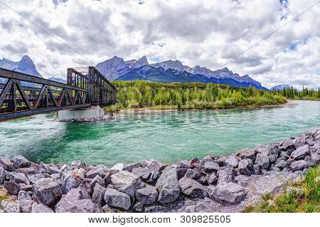 Historic Canmore Engine Bridge Over The Bow River In The Canadian Rockies With Ha Ling Peak And Mt R