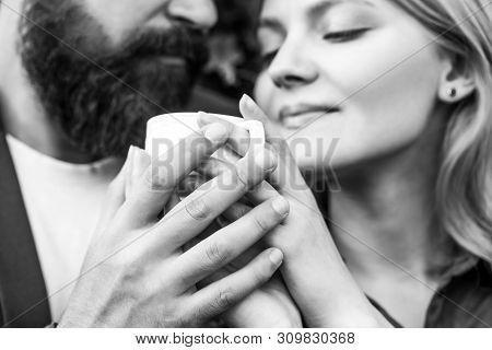 Couple Enjoying Coffe. Lovely Couple Holding Cup Of Coffe In Hands. Bearded Man Hugs Girl. Female An