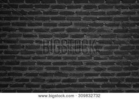 Wall dark brick wall texture background. Brickwork or stonework flooring interior rock old pattern clean concrete grid uneven bricks design stack.  poster