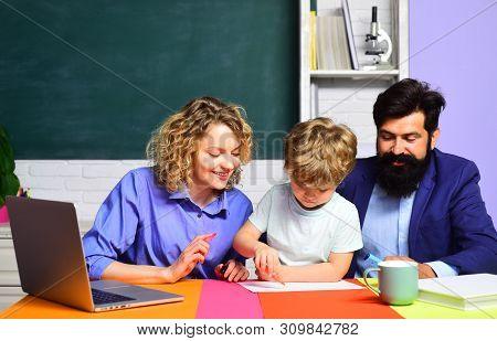 Children Education And Pupil Education. Back To School. Home Schooling. Cute Pupil And His Father An