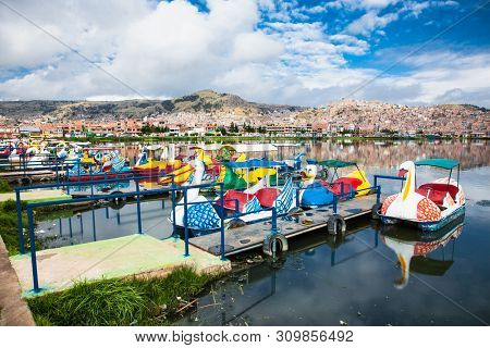 Puno, Peru-Jan 5, 2019: Boats and panoramic view on Puno from Titicaca lake, Peru. South America.