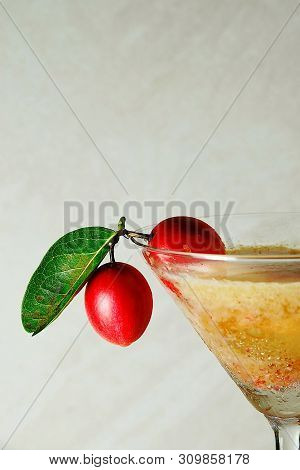 Organic Food, Non-toxic Closeup Fresh Carissa Carandas Or Bengal Currants Fruits And Glass Of Juice