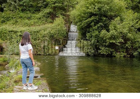 Povoa De Lanhoso, Portugal - June 20, 2019 : Woman Looking At The Waterfall, River Beach Of Rola Rio