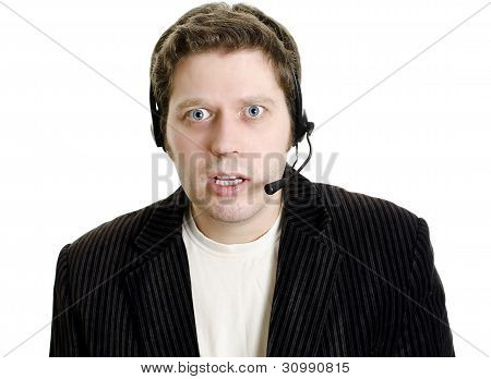 Sports Commentator Or Customer Support With Headphones In Shock. Isolated On White.