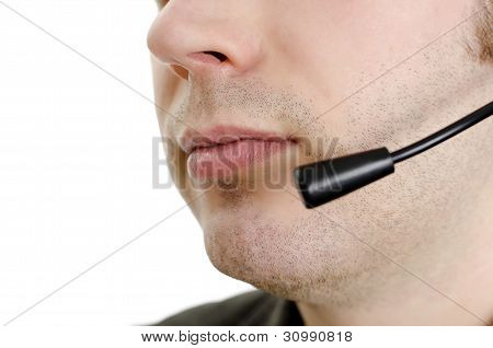Closeup Of Operator's Mouth With Microphone. Isolated On White.