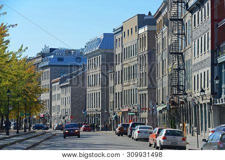 Montreal, Canada - Nov 2, 2012: Historic Buildings On Rue De La Commune In Old Montreal, Quebec, Can