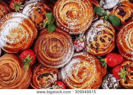 Cinnamon Raisin Bun Sweet Roll Pastry Flat Lay. Danish Bakery Cake With Strawberry And Sugar Powder