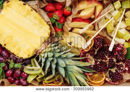 Fruit Mix Background Catering Service Top View. Organic Variety Pineapple And Garnet Present Deliver