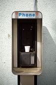 Telephone been replaced by a Styrofoam cup. poster