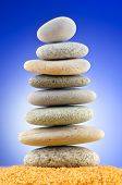 Balanced pebbles with colour background poster