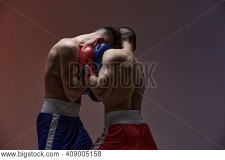 Wrestling Of Two Fighting Males Boxers In Boxing Gloves In Red Light In Studio, Martial Arts, Mixed